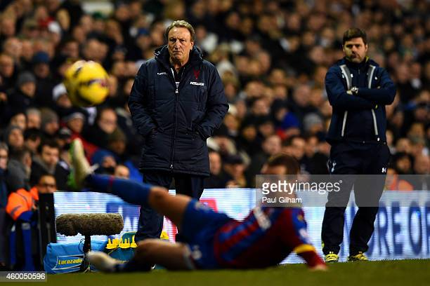 Manager Neil Warnock of Crystal Palace and looks on next to manager Mauricio Pochettino of Spurs during the Barclays Premier League match between...