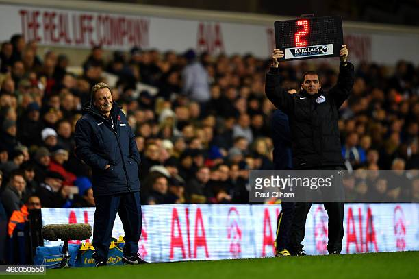 Manager Neil Warnock of Crystal Palace laughs as fourth official Phil Dowd shows the time to be added to the second half during the Barclays Premier...