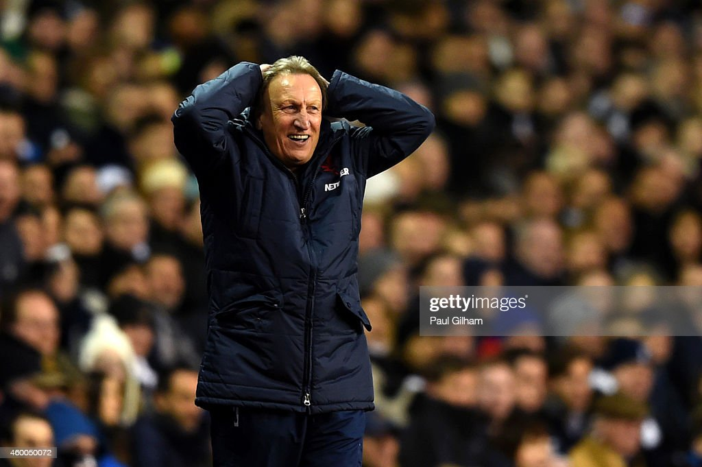 Manager Neil Warnock of Crystal Palace reacts on the touchline during the Barclays Premier League match between Tottenham Hotspur and Crystal Palace at White Hart Lane on December 6, 2014 in London, England.