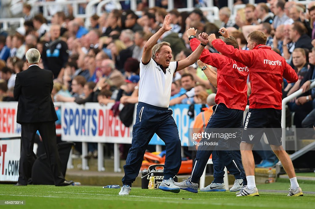 Manager Neil Warnock of Crystal Palace turns to celebrate with his coaching staff after Wilfried Zaha of Crystal Palace scored their third goal and equaliser in stoppage time during the Barclays Premier League match between Newcastle United and Crystal Palace at St James' Park on August 30, 2014 in Newcastle upon Tyne, England.