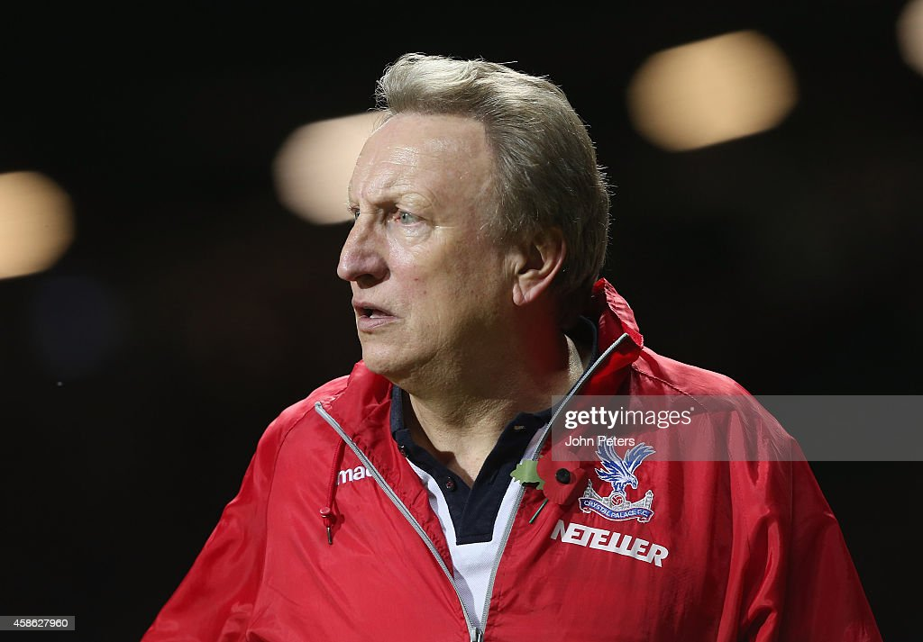 Manager Neil Warnock of Crystal Palace walks off after during the Barclays Premier League match between Manchester United and Crystal Palace at Old Trafford on November 8, 2014 in Manchester, England.