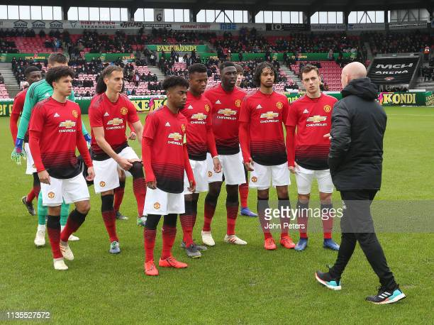 Manager Nicky Butt speaks to the Manchester United U19 team ahead of the UEFA Youth League match between Midtjylland U19s and Manchester United U19s...