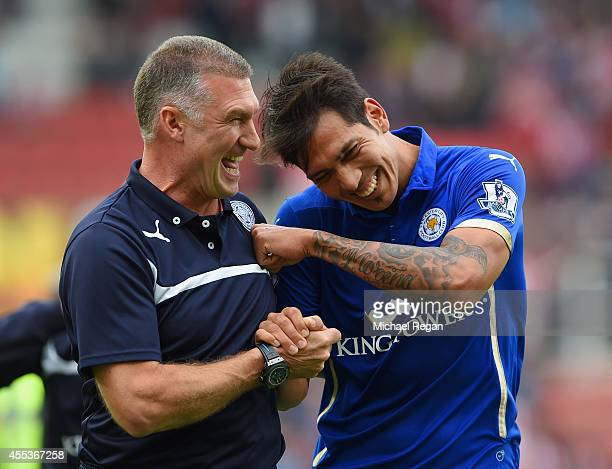 Manager Nigel Pearson of Leicester City celebrates with Leonardo Ulloa of Leicester City after victory during the Barclays Premier League match...