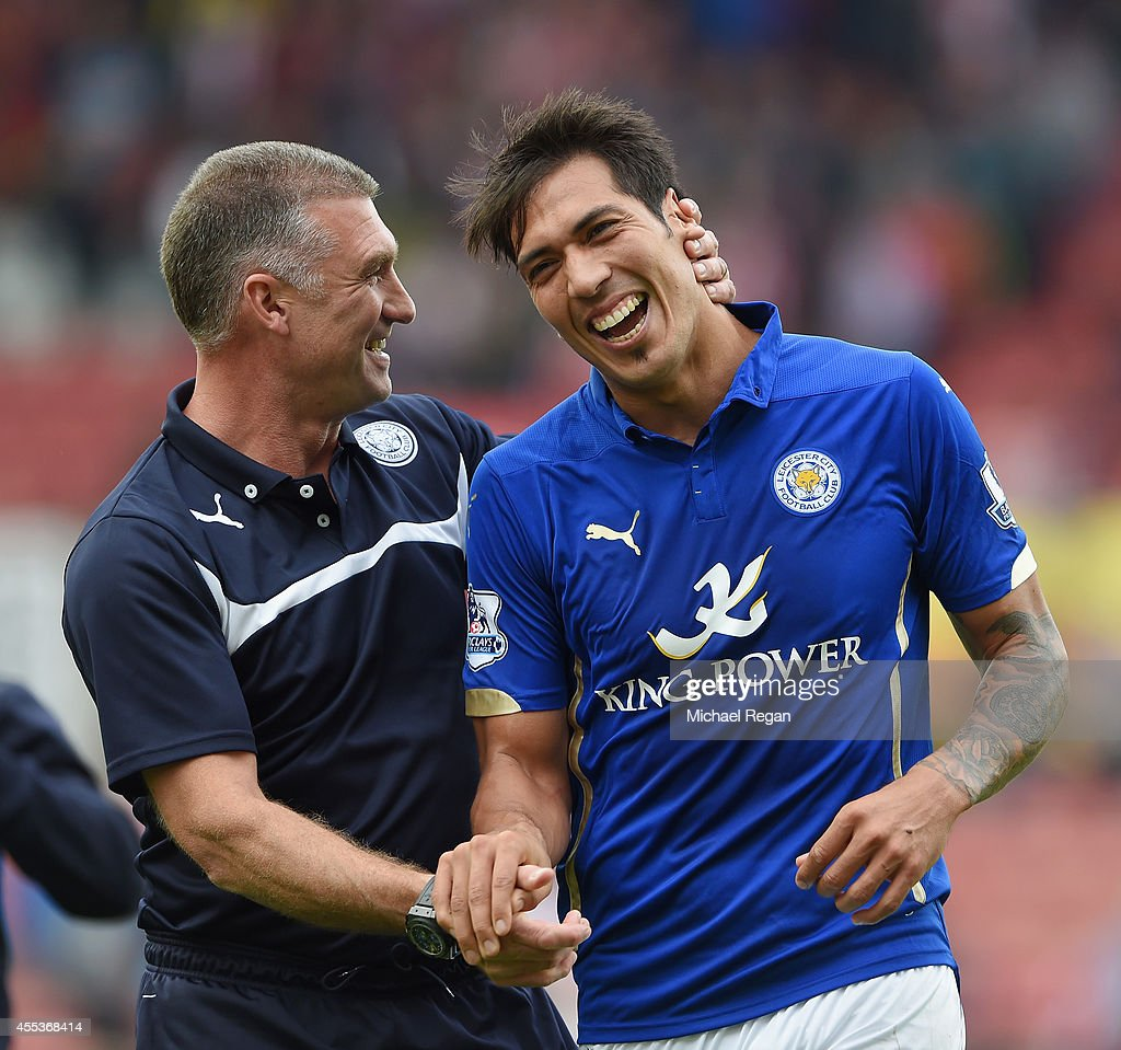 Manager Nigel Pearson of Leicester City celebrates with Leonardo Ulloa of Leicester City after victory during the Barclays Premier League match between Stoke City and Leicester City at Britannia Stadium on September 13, 2014 in Stoke on Trent, England.