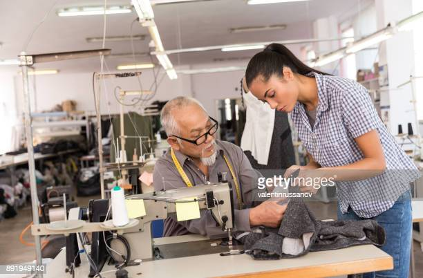 Manager observing production in factory