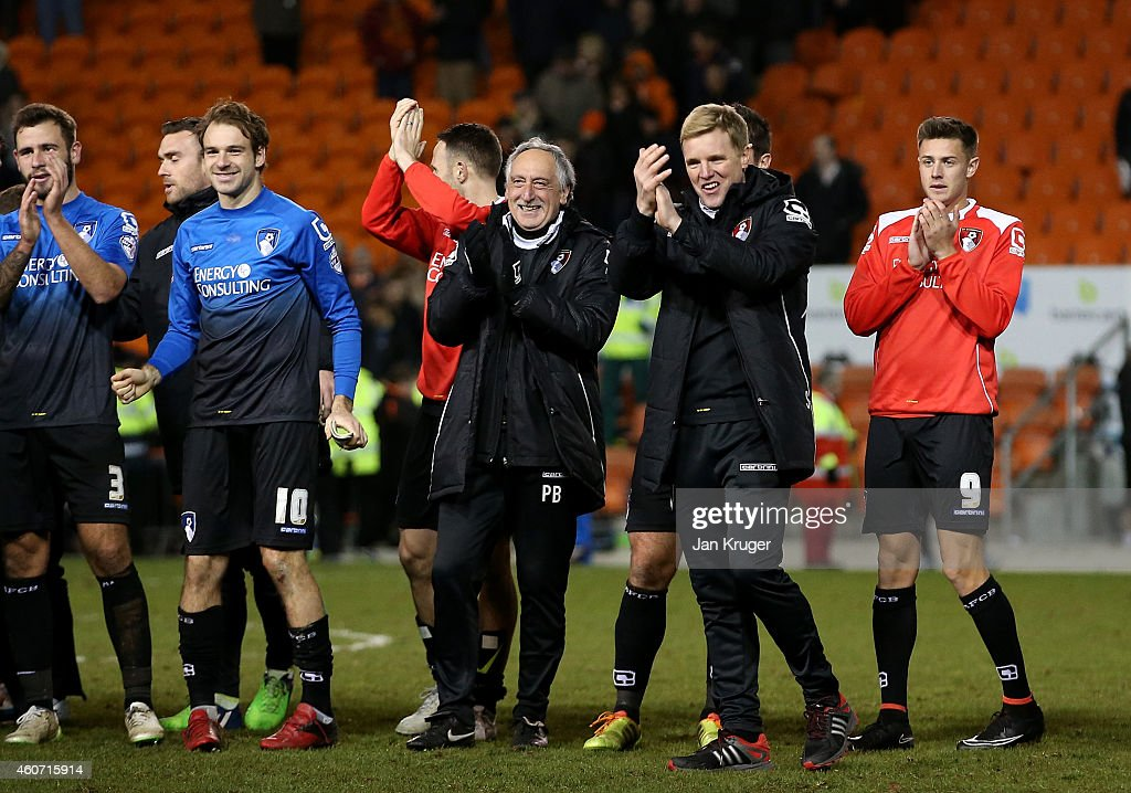 Manager of AFC Bournemouth Eddie Howe(2ndR) applauds the travelling supporters after his side scored six goals during the Sky Bet Championship match between Blackpool and Bournemouth at Bloomfield Road on December 20, 2014 in Blackpool, England.