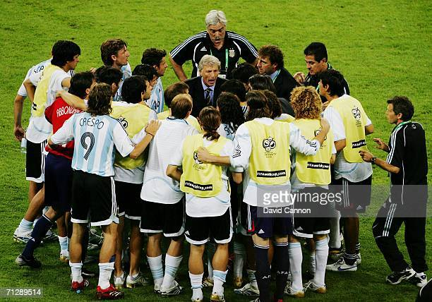 Manager of Argentina Jose Pekerman gives a team talk to his players before the start of extra time during the FIFA World Cup Germany 2006 Round of 16...