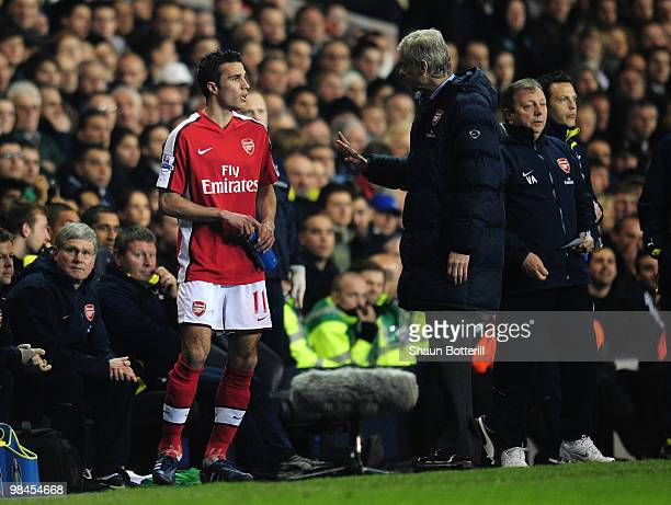 Manager of Arsenal Arsene Wenger speaks to Robin Van Persie before bringing him on during the Barclays Premier League match between Tottenham Hotspur...