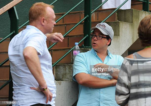 Manager of Aston Villa FC Alex McLeish and comedian Michael McIntyre attend Day Seven of the Wimbledon Lawn Tennis Championships at the All England...