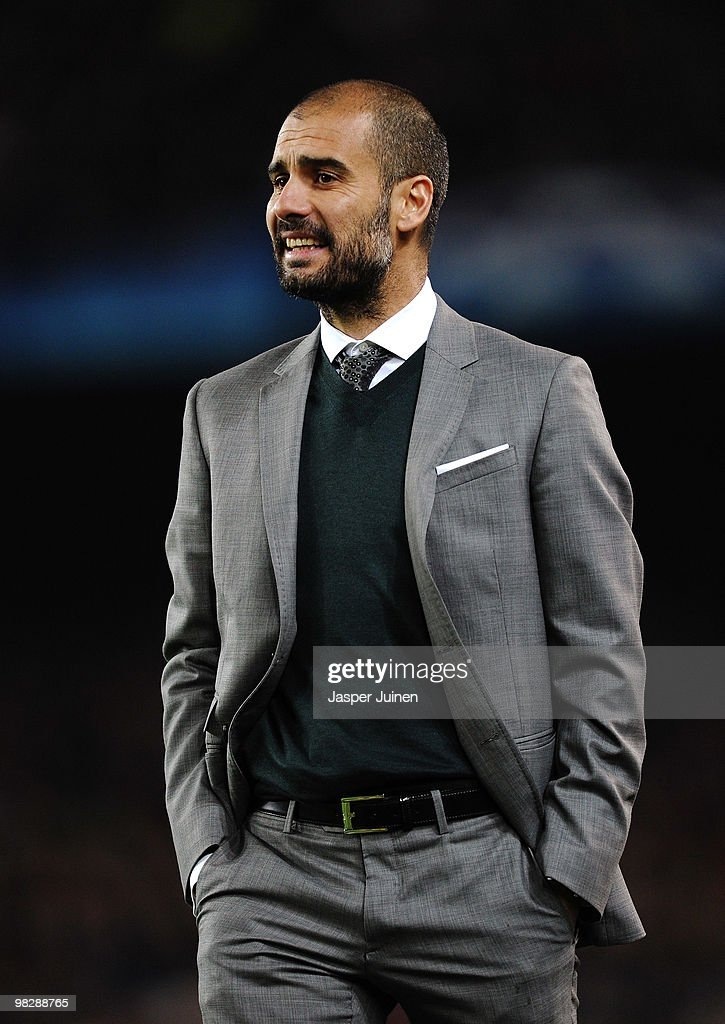 Manager of Barcelona Josep Guardiola smiles during the UEFA Champions League quarter final second leg match between Barcelona and Arsenal at Camp Nou on April 6, 2010 in Barcelona, Spain.