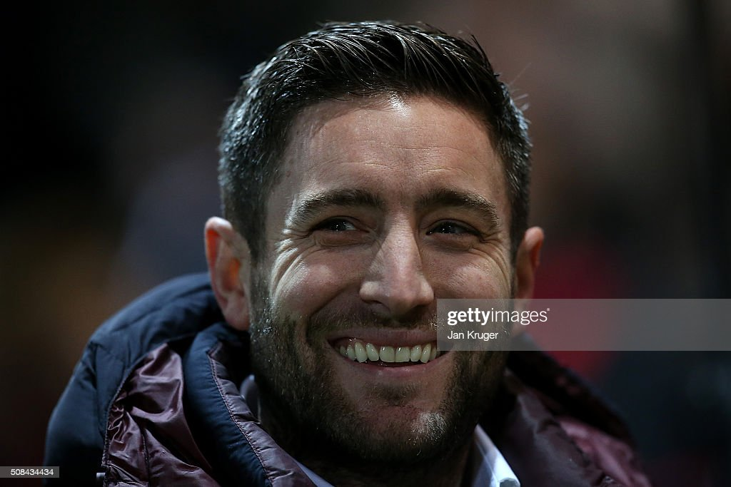 Manager of Barnsley Lee Johnson looks on during the Johnstone's Paint Trophy northern section semi final second leg match between Fleetwood Town and Barnsley at Highbury Stadium on February 4, 2016 in Fleetwood, England.