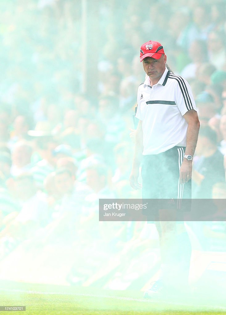 Manager of Brentford Uwe Rosler looks on during a pre season friendly match between Brentford and Celtic at Griffin Park on July 20, 2013 in Brentford, England.