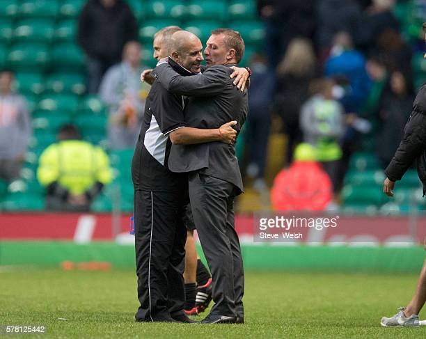 Manager of Celtic Brendan Rodgers hugs Manager of Lincoln Red Imps Julio Cesar Ribas at the end of the UEFA Champions League Second Qualifying Round...