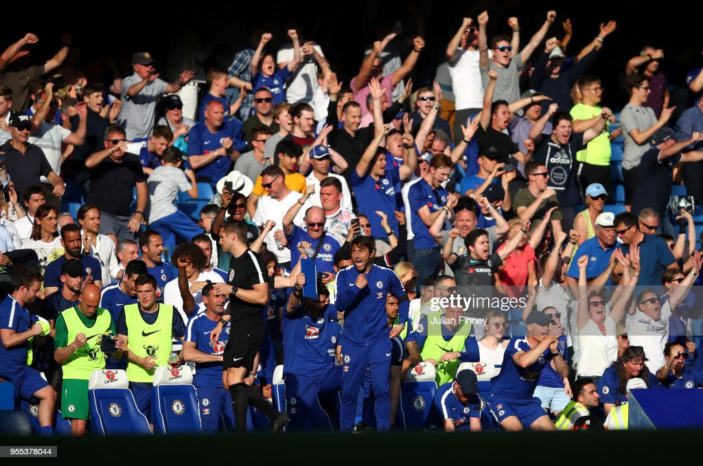 Manager of Chelsea Antonio Conte celebrates at full time after their 1-0 win during the Premier League match between Chelsea and Liverpool at Stamford Bridge on May 6, 2018 in London, England.