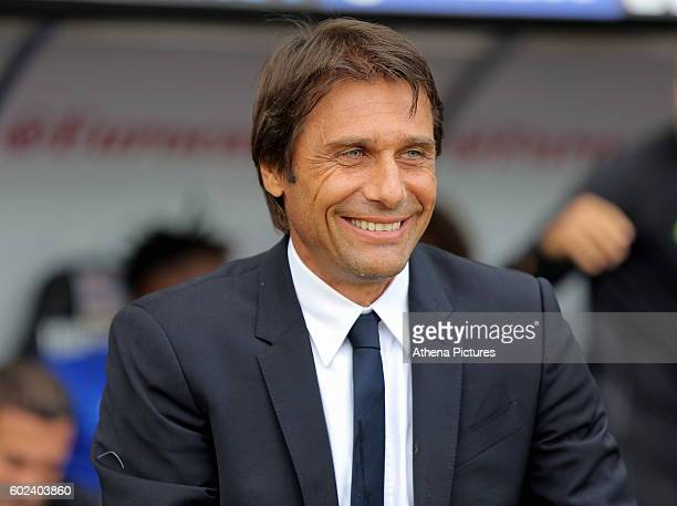 Manager of Chelsea Antonio Conte smiles during the Premier League match between Swansea City and Chelsea at The Liberty Stadium on September 11 2016...