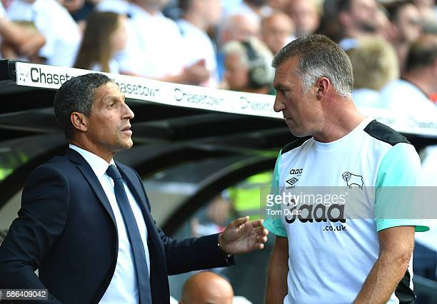 Manager of Derby County Nigel Pearson and manager of Brighton Hove Albion Chris Hughton chat prior to the Sky Bet Championship match between Derby...
