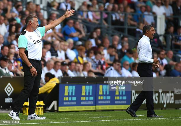 Manager of Derby County Nigel Pearson and manager of Brighton Hove Albion Chris Hughton give instructions during the Sky Bet Championship match...