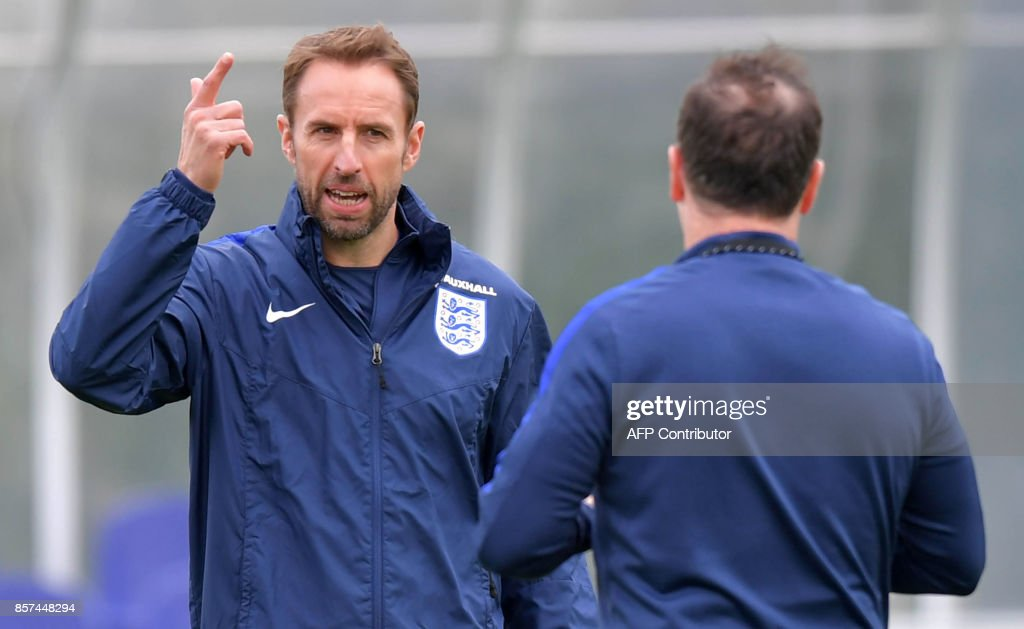 Manager of England's national football team, Gareth Southgate gestures during a team training session at the Tottenham Hotspur Training Ground in Enfield, north London on October 4, 2017. USE