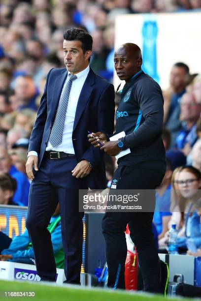 Manager of Everton Marco Silva talks with assistant Luis Boa Morte during the Premier League match between Everton FC and Watford FC at Goodison Park...