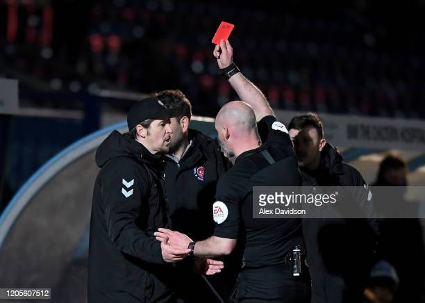 Manager of Fleetwood Town, Joey Barton reacts as he receives red card from referee Kevin Johnson during the Sky Bet League One match between Wycombe...
