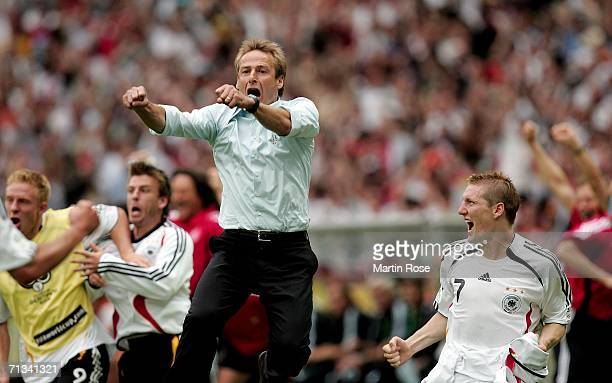 Manager of Germany Juergen Klinsmann and Bastian Schweinsteiger celebrate Miroslav Klose's equalising goal during the FIFA World Cup Germany 2006...