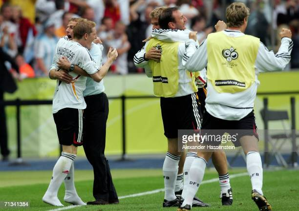 Manager of Germany Juergen Klinsmann celebrates Miroslav Klose's equalising goal with the German players during the FIFA World Cup Germany 2006...