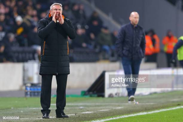 Manager of Hull City Nigel Adkins shouts instructions to his team as Reading's manager Jaap Stam looks on during the Sky Bet Championship match...