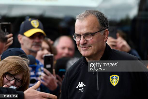 Manager of Leeds United Marcelo Bielsa greets fans as he arrives at the stadium prior to the Sky Bet Championship match between Leeds United and...