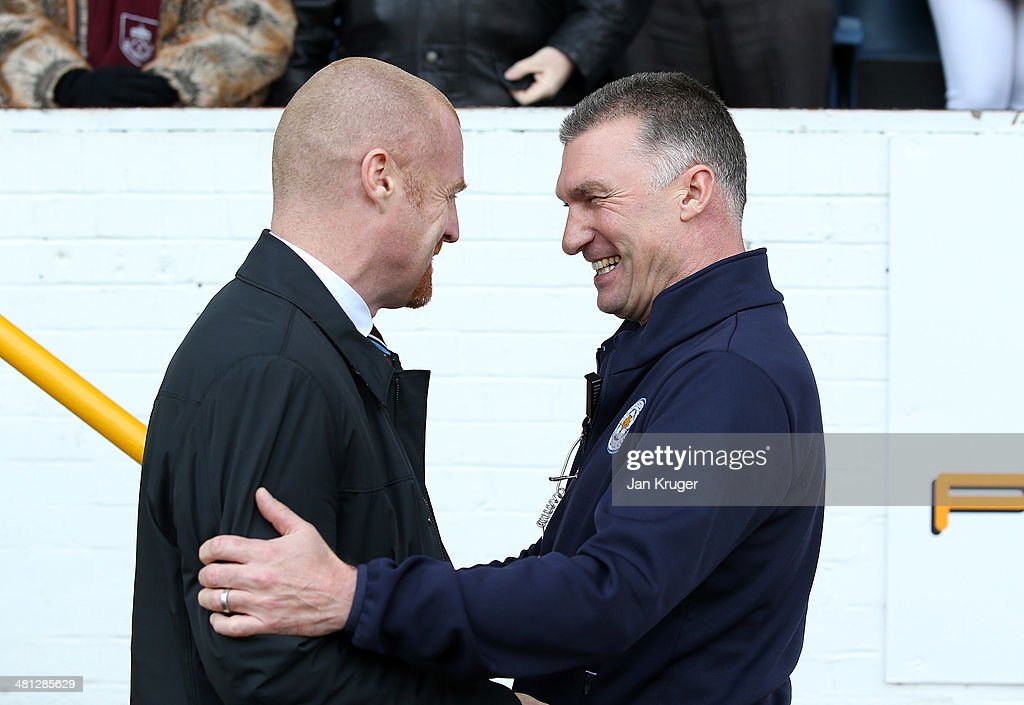 Manager of Leicester City Nigel Pearson (R) and Manager of Burnley Sean Dyche share a joke ahead of the Sky Bet Championship match between Burnley and Leicester City at Turf Moor on March 29, 2014 in Burnley, England.