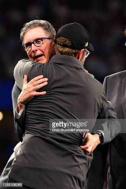 Manager of Liverpool, Jurgen Klopp hugs Owner of Liverpool John Henry as they celebrate after their side won during the UEFA Champions League Final...