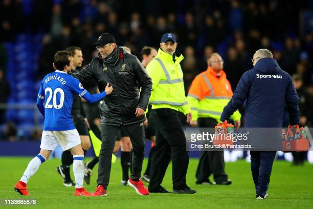 Manager of Liverpool Jurgen Klopp shakes hands with Bernard of Everton after the Premier League match between Everton FC and Liverpool FC at Goodison...