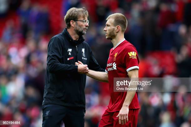 Manager of Liverpool Jurgen Klopp talks with Ragnar Klavan of Liverpool during the Premier League match between Liverpool and Stoke City at Anfield...