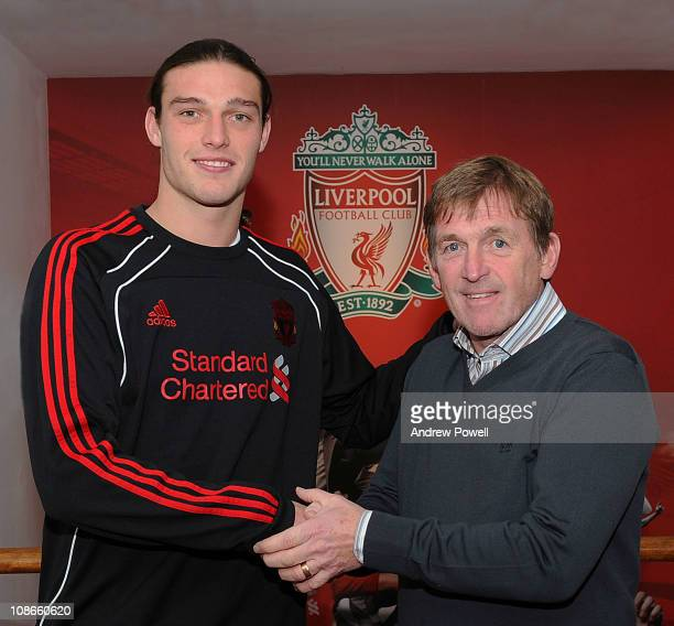 Manager of Liverpool Kenny Dalglish shakes hands with his new record signing Andy Carroll at Melwood Training Ground on January 31 2011 in Liverpool...