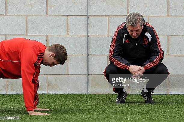 Manager of Liverpool Roy Hodgson talks with team captain Steven Gerrard during a Liverpool FC training session, at Melwood training ground on...