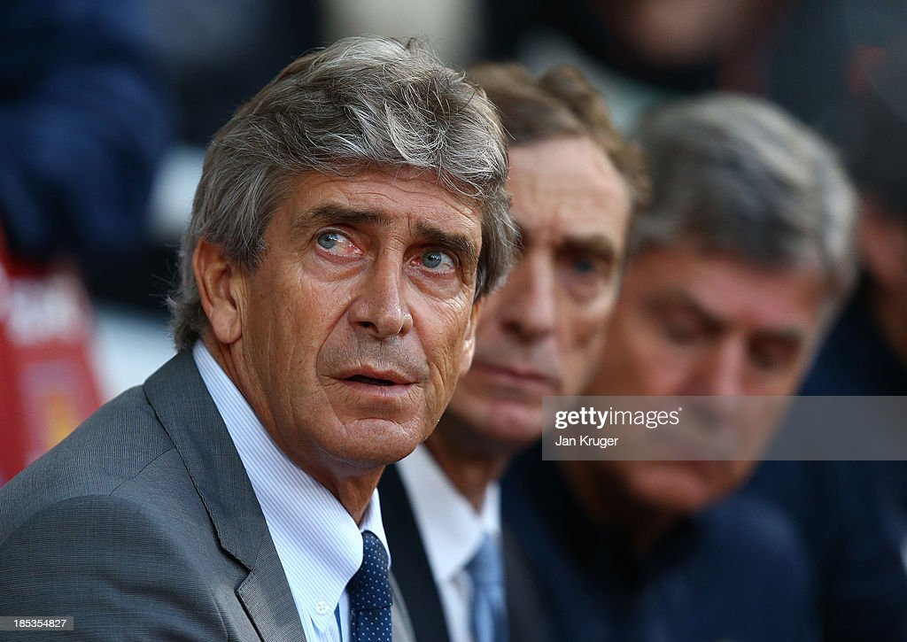 Manager of Manchester City Manuel Pellegrini looks on during the Barclays Premier League match between West Ham United and Manchester City at the Boleyn Ground on October 19, 2013 in London, England.