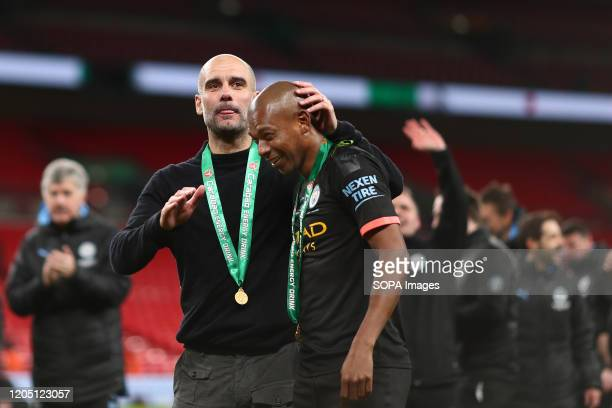 Manager of Manchester City Pep Guardiola and Fernandinho of Manchester City celebrate after the Carabao Cup Final match between Aston Villa and...