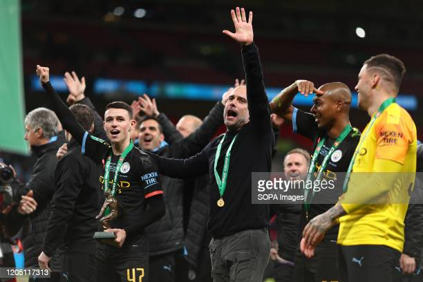 Manager of Manchester City Pep Guardiola celebrates with Phil Foden of Manchester City after the Carabao Cup Final match between Aston Villa and...
