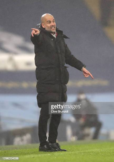 Manager of Manchester City, Pep Guardiola gives their team instructions during the Premier League match between Manchester City and Brighton & Hove...