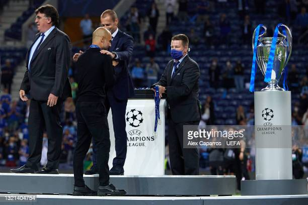 Manager of Manchester City Pep Guardiola receives his finalist medal from UEFA President Aleksander Ceferin after the UEFA Champions League Final...