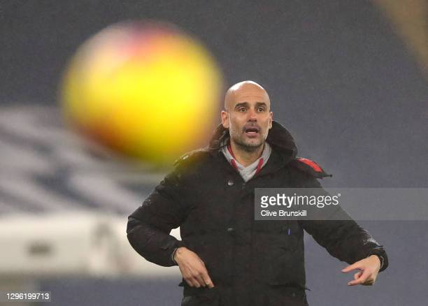 Manager of Manchester City, Pep Guardiola watches on during the Premier League match between Manchester City and Brighton & Hove Albion at Etihad...