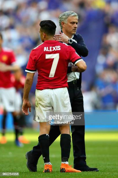 Manager of Manchester United Jose Mourinho hugs Alexis Sanchez of Manchester United after the Emirates FA Cup Final between Chelsea and Manchester...