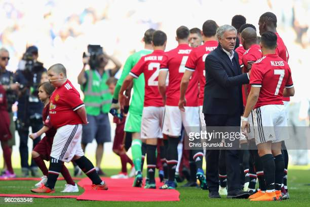 Manager of Manchester United Jose Mourinho talks with Alexis Sanchez of Manchester United before the Emirates FA Cup Final between Chelsea and...