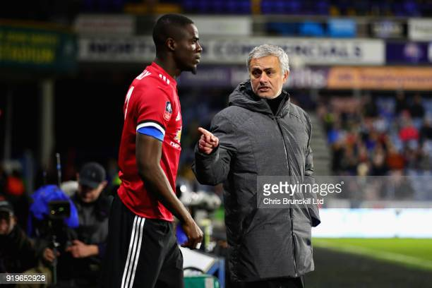 Manager of Manchester United Jose Mourinho talks with Eric Bailly of Manchester United on the sidelines during the Emirates FA Cup Fifth Round match...