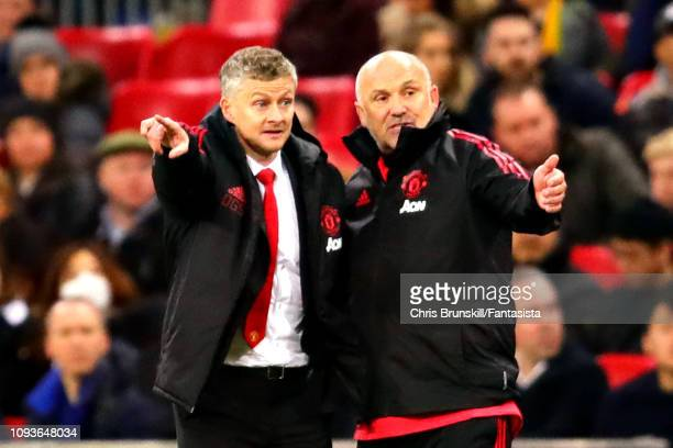 Manager of Manchester United Ole Gunnar Solskjaer and assistant Mike Phelan talk on the sideline during the Premier League match between Tottenham...