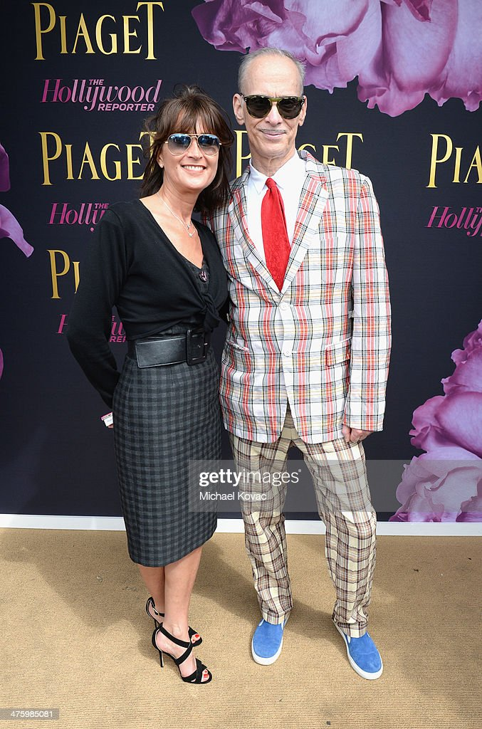 PR Manager of Piaget Natacha Hertz and John Waters pose in the Piaget Lounge during the 2014 Film Independent Spirit Awards at Santa Monica Beach on March 1, 2014 in Santa Monica, California.