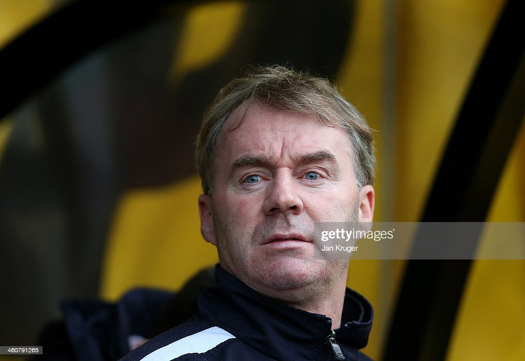 Manager of Plymouth Argyle John Sheridan looks on during the Budweiser FA Cup third round match between Port Vale and Plymouth Argyle at Vale Park on January 5, 2014 in Burslem, England.