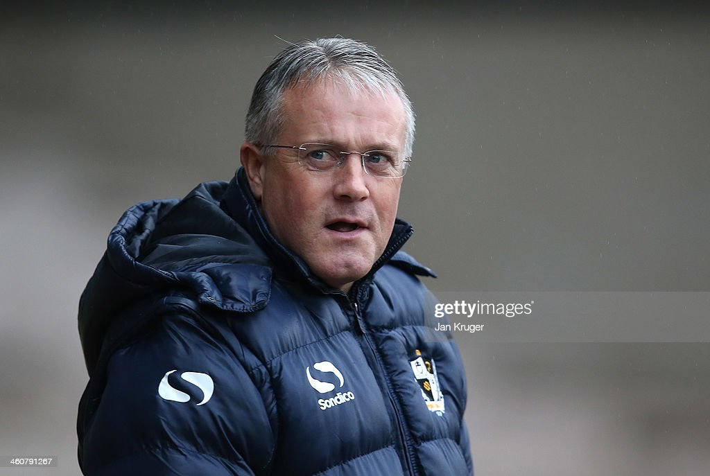 Manager of Port Vale Micky Adams looks on during the Budweiser FA Cup third round match between Port Vale and Plymouth Argyle at Vale Park on January 5, 2014 in Burslem, England.