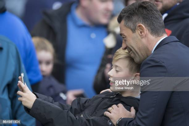 Manager of Rangers Pedro Caixinha smiles for a selfie with young fan before the Betfred Cup Semi Final at Hampden Park on October 22 2017 in Glasgow...
