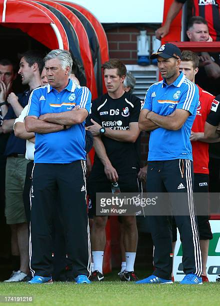 Manager of Real Madrid Carlo Ancelotti and Assistant Manager of Real Madrid Zinedine Zidane looks on ahead of the pre season friendly match between...