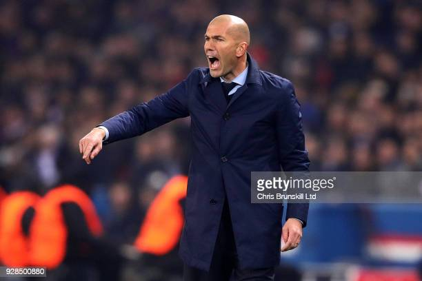 Manager of Real Madrid Zinedine Zidane points from the sideline during the UEFA Champions League Round of 16 Second Leg match between Paris...